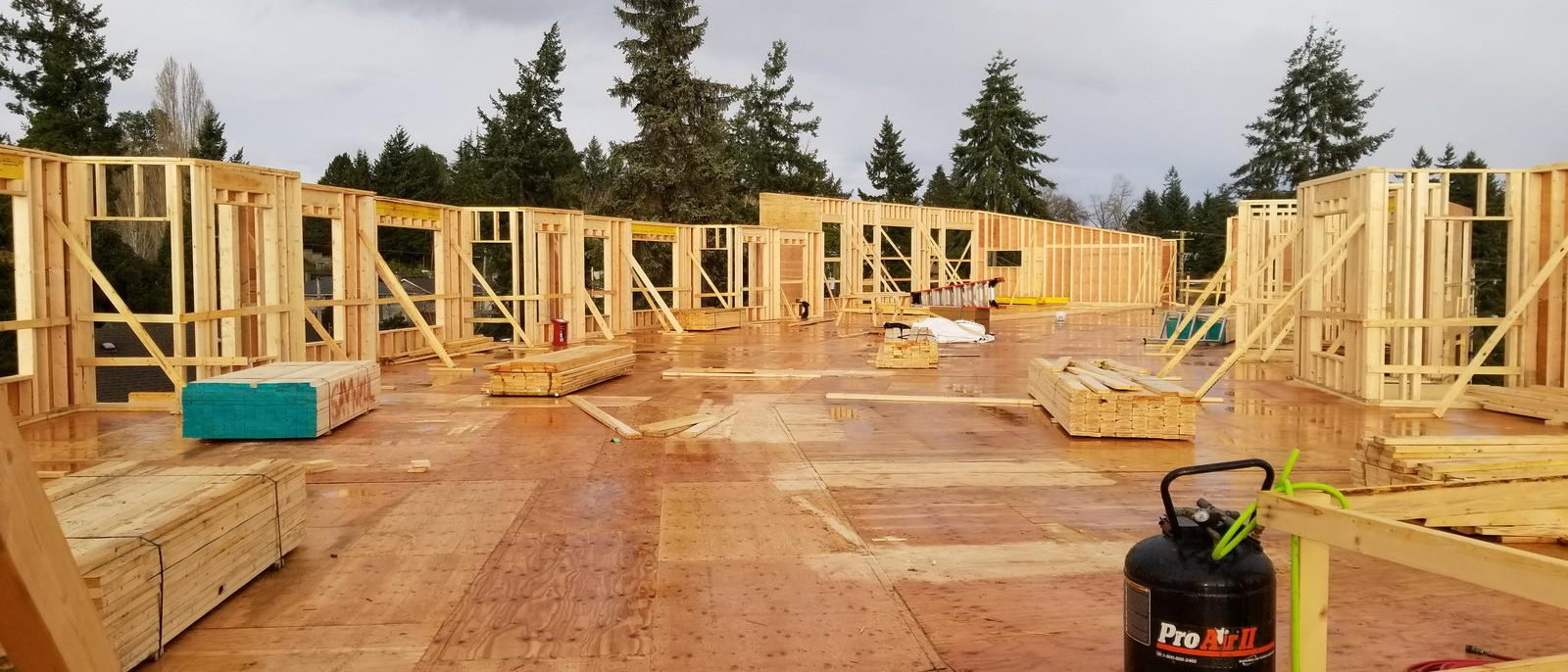 Framing exterior of apartment building construction project on Vancouver Island, BC